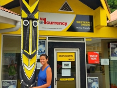 Becky with a totem outside Western Union; Luganville