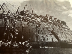 Unbelievably, only 2 people perished when the SS Coolidge struck a mine in 1942. This photo shows the quick evacuation in action