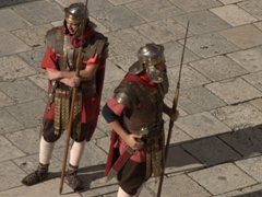 Roman guards waiting for tourists at the Peristyle