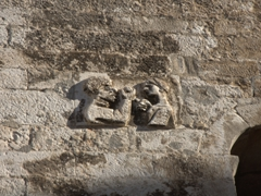 Stone relief of Adam taking the apple from Eve; west wall of Diocletian Palace