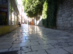 Limestone street in Split, polished by constant use