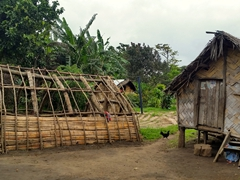 Typical village huts - the left hut will be cyclone proof upon completion