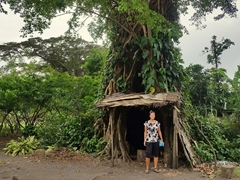 Becky at the entrance of a banyan tree hut