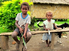 Both children are carrying large knives - only in Vanuatu!