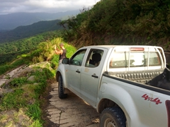 Robby taking a photo of the stunning landscape. 4WD transport is essential as Tanna's roads are in rough shape