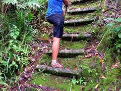 Becky climbing one of 56 ladders leading up to Mount Alava - this hike is no joke and we were both drenched in sweat!