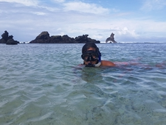 Becky enjoying the snorkeling at 2 Dollar Beach