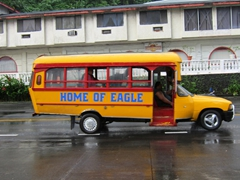 Public buses are converted pick up trucks - we loved riding them at an affordable $1 per ride!