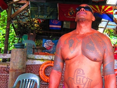 Our tattooed bartender; Tisa's Barefoot Bar