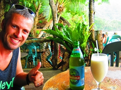 Thumbs up for our beer and pina colada; Tisa's Barefoot Bar