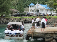 Church members crowding onto a ferry at Auasi for the ride out to Aunuu island