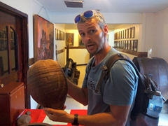 Robby demonstrates that this coconut is bigger than his head!