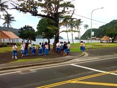 School children wait for the bus