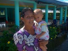 Our Saleaula lava field tour guide poses with her newborn baby