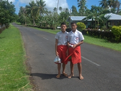 School boys in their lava lava (skirt) walk home for lunch