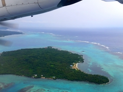 View of a Samoan island as we are about to land at Faleolo International Airport