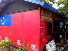 Samoan flag painted on this barber shop; Apia