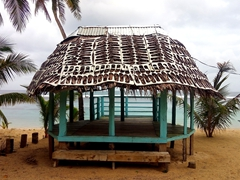 Typical beach fale - notice the flip flop cut-outs on top of the roof!
