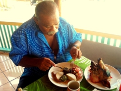 The guest of honor gets to devour the entire pig's head; Sunday umu feast