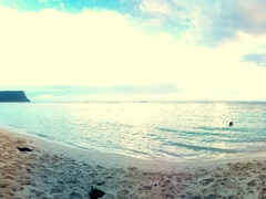 Panorama of Robby enjoying a sundowner at Lalomanu Beach