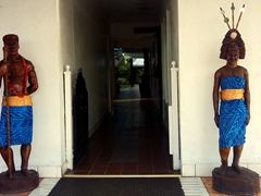 Samoan statues guard the entrance to a hotel; Apia