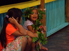 Well behaved Samoan girls watch eagerly from the sidelines