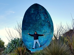 Becky standing in a massive paua shell; Riverton