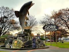 Robby next to Gore's famous trout statue