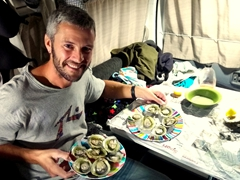 Robby smiles after preparing our shelled oysters from Bluff