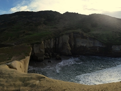 Panorama of Tunnel Beach, a must see if visiting Dunedin