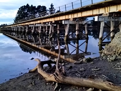 Wooden rail bridge reflection at Waikouaiti River; Karitane