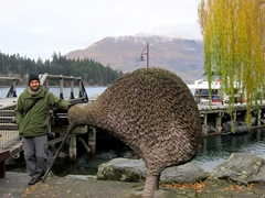 Robby next to a giant kiwi; Queenstown