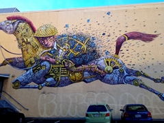 """Riding the Dreams"" by Italian artist Pixel Pancho; Dunedin street art"