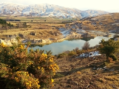 Man made lake of St Bathans, a former gold and coal mining town of 2000 inhabitants
