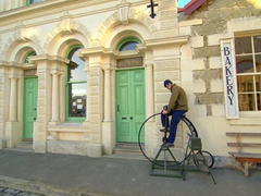 Robby rides a Penny Farthing in Oamaru's Victorian District