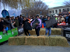Sprinting with heavy bags during a hospitality contest; Queenstown Winter Festival