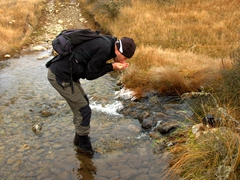 Damien stopping for a refreshing sip of mountain stream water