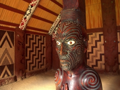 Detailed carving inside the Whaakata (Meeting House); Okains Bay Maori Museum