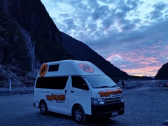 At sunset, we are one of a few cars remaining in the parking lot; Fox Glacier