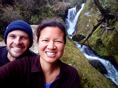 Posing by the waterfall in Bark Bay; Abel Tasman