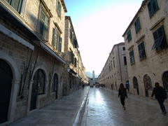 The wide, gleaming limestone main street known as stradun lined with shops and cafes. Later in the day, stradun becomes packed with tourists