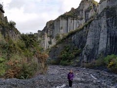 Becky dwarfed by the Putangirua Pinnacles