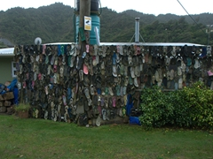 Shoes hanging on the fence; near Three Sisters Rock Formation
