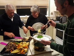 Warwick and Marion serving up a yummy lamb roast for dinner; Masterton