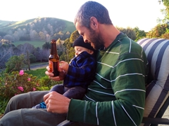 Even at 11 months old, Zane is already showing an interest in Tui beer