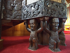 Pulpit supported by Maori gods; St Mary's Church in Tikitiki
