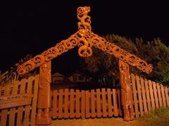 Carved Maori gate; Papatea Bay