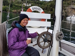 Becky takes a hand at steering our yacht; Lake Taupo