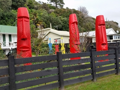 Colorful wooden carvings; Coromandel Peninsula