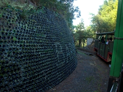 Retaining wall made from recycled bottles. Driving Creek Railway was built by Barry Brickell, a passionate conservationist